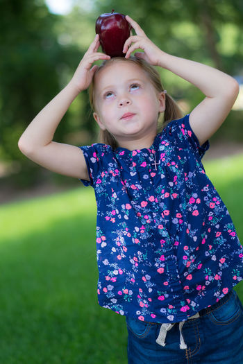 Portrait of girl playing on grass