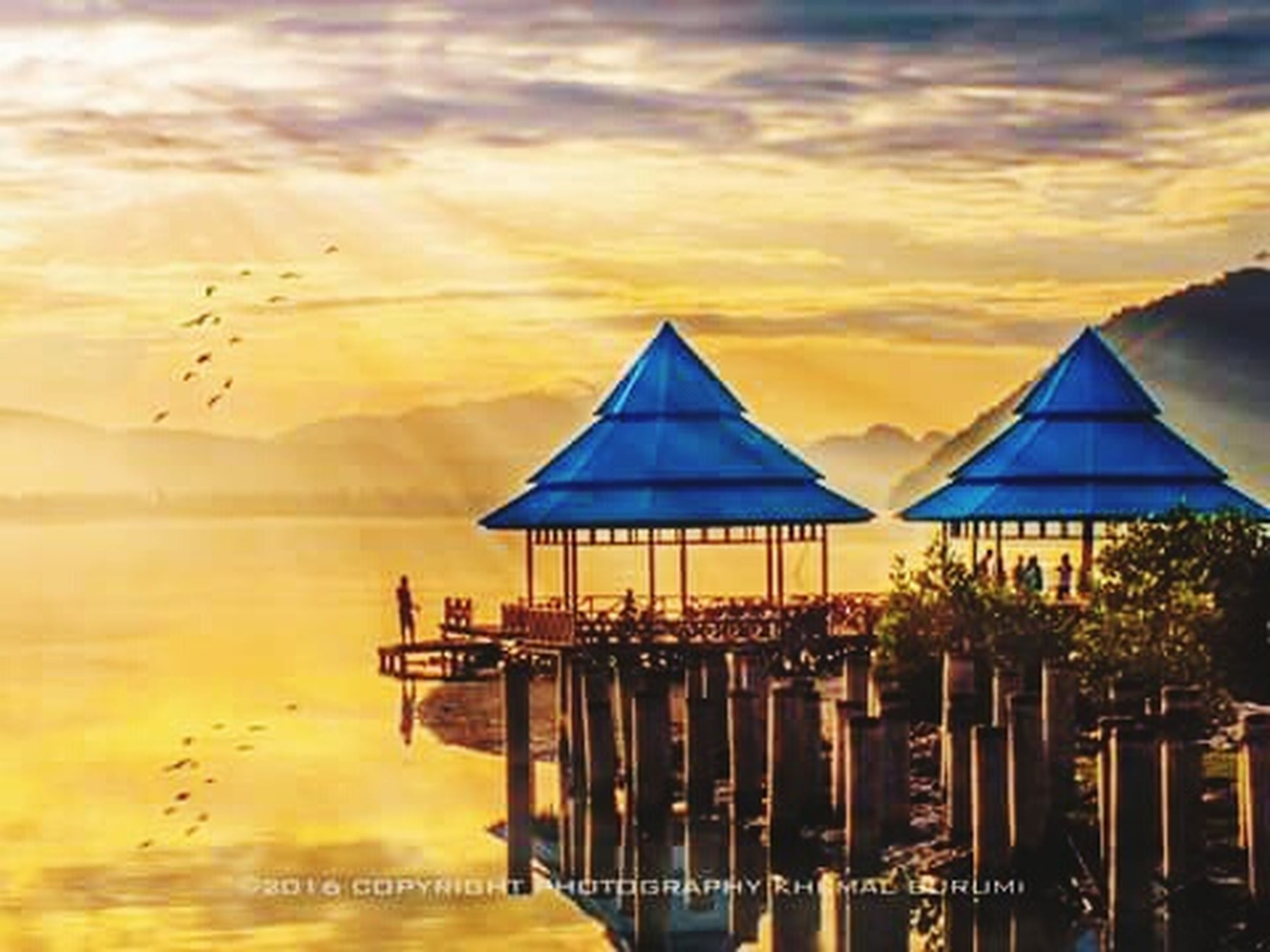 water, cloud - sky, architecture, sky, sunset, nature, sea, no people, building exterior, built structure, travel destinations, land, tranquility, beauty in nature, reflection, pier, outdoors, building, beach, luxury