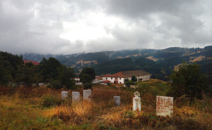 Mountain landscape and a cemetery Cemetery Cemetery Photography Cloudy Landscape_Collection Nature Rural Weather Architecture Building Built Structure Cloud - Sky Countryside Environment Graves Historic House Land Landscape Mountain Mountains Nature No People Outdoors Scenics - Nature Sky