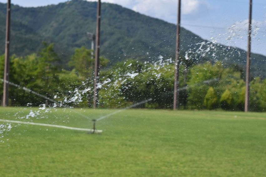 Water Sprinkler Spraying Drop Grass Day No People Wet Green Color Outdoors Motion Nature Mountain Shower Beauty In Nature Freshness