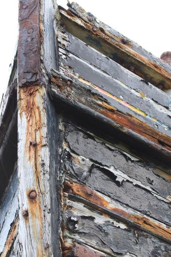 Decaying boat, Burghead, Scotland Wood - Material Weathered Low Angle View No People Day Outdoors Textured  Rusty Close-up Nature Sky Boat Paint Pealing Paint EyeEmNewHere
