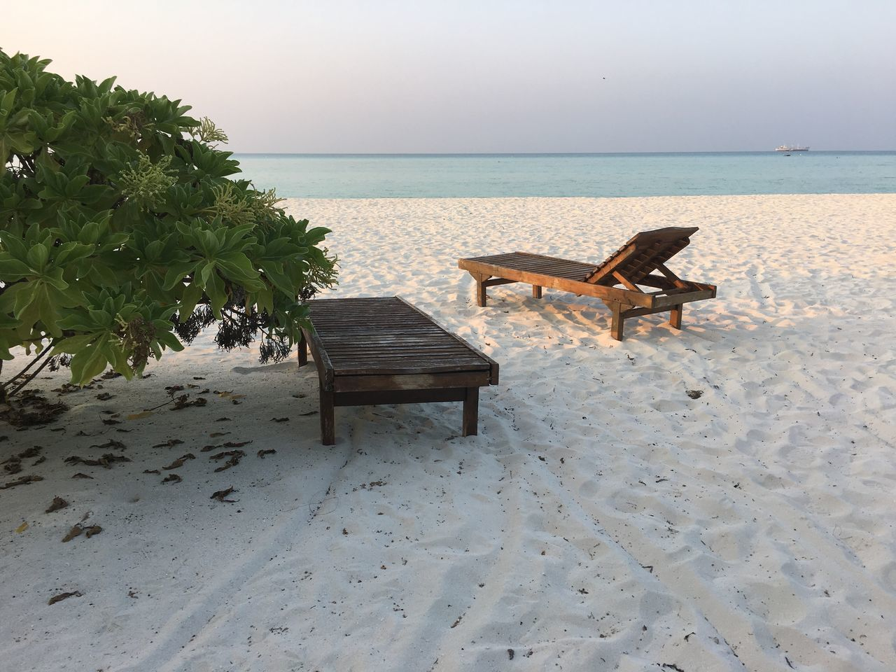 sea, horizon over water, beach, water, nature, sand, table, scenics, chair, tranquility, beauty in nature, tranquil scene, no people, outdoors, clear sky, day, sky