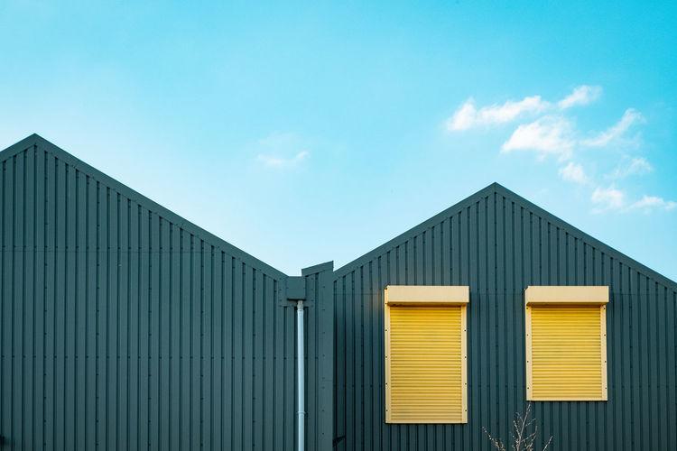 Factory building against blue sky