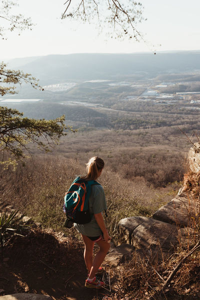 Travel Traveling Backpack Beauty In Nature Casual Clothing Day Domestic Animals Friendship Full Length Hiking Leisure Activity Lifestyles Mountain Nature One Person Outdoors Pets Rear View Scenics Sky Standing Travel Destinations Tree Water