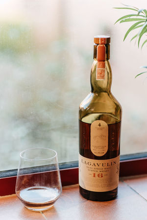 Whisky Alcohol Bottle Close-up Container Cork - Stopper Corkscrew Drink Drinking Glass Focus On Foreground Food And Drink Glass Glass - Material Household Equipment Indoors  Lagavulin No People Refreshment Table Transparent Whiskey Wine Wine Bottle