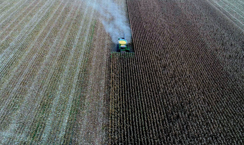 Aerial View Of Combine Harvester Harvesting Crops At Farm