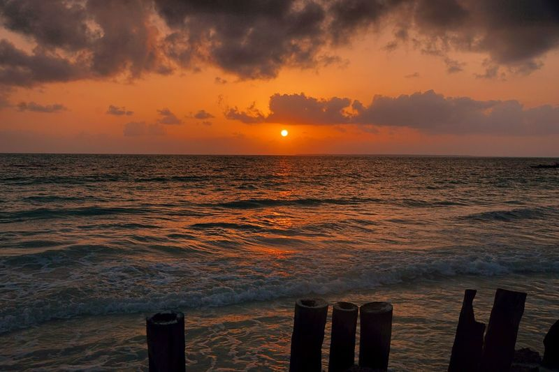 Sunrise at Uroa Beach, Zanzibar Sunrise Sun Silhouette Zanzibar Uroa Beach Travel Destinations Travel Photography Golden Hour Ocean Nautical Vessel Sea Sunset Wave Backgrounds Horizon