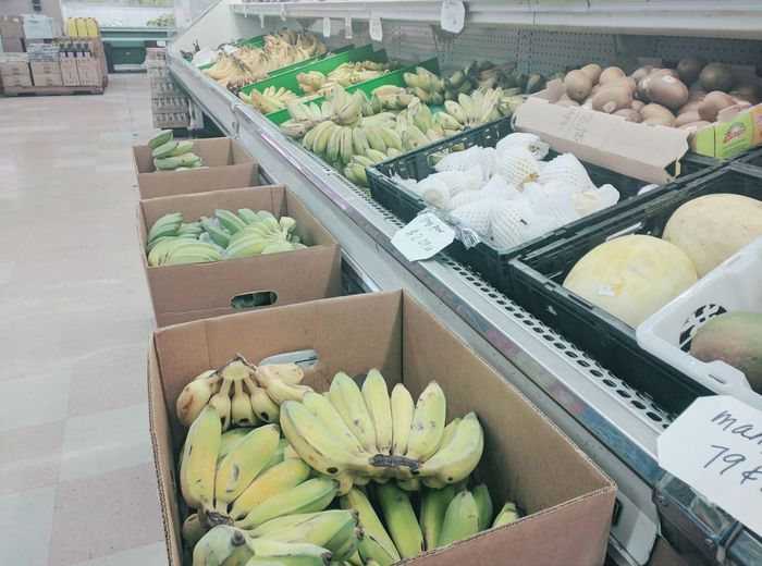 At the market, down the street. Market Supermarket Fruits Bananas Pears Carboard Store Aisles Produce Tiled Floor Yellow Hues Walking Around Shoping Fruits ♡ Kiwis Indoors  No People Green Bananas Healthy Food Healthy Choice