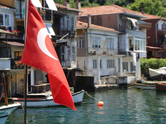 Near the water... aTurkish flag dies in the breeze as the others car etc crop up now Boats Building Exterior Built Structure City Day End Of Cruise Flag Harbor Istanbul Mode Of Transport Nature Nautical Vessel Outdoors Patriotism Red Sea Transportation Turkey Water Waterfront Yacht