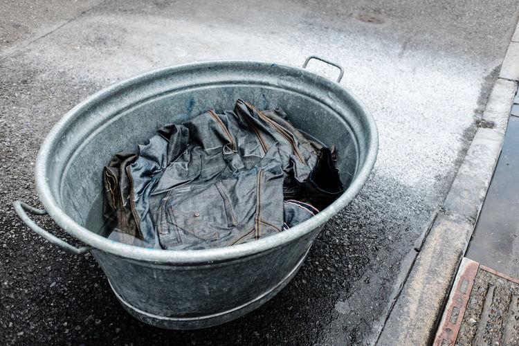 Clothes Denim Denim Fashion Denim Jacket Denimjeans Denimshirt Fabric Fabric Washing Fabrics Fashion Handwash Handwashing Jeans Metal Bucket No People Object Objects On The Road On The Street Outdoors Road Soak Soaking  Washing Washing Bucket