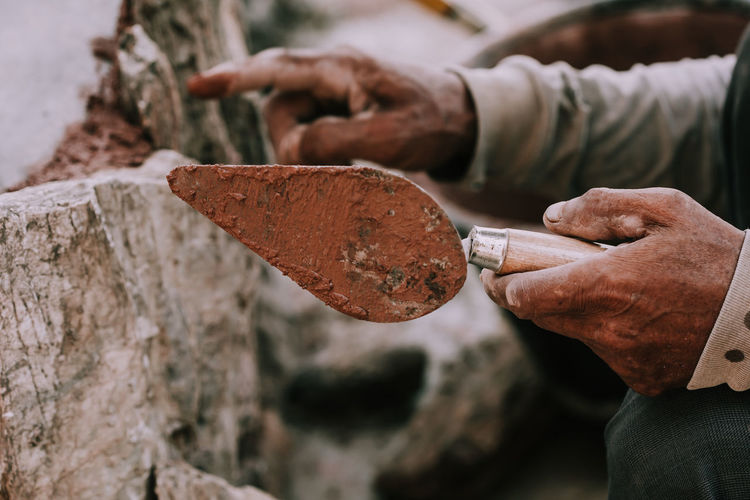 Art And Craft Chisel Craft Craftsperson Creativity Focus On Foreground Hand Hand Tool Holding Human Body Part Human Hand Occupation One Person Real People Sculptor Selective Focus Skill  Tool Work Tool Working Workshop