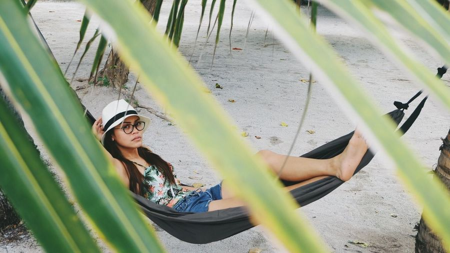 High angle view of young woman in hammock