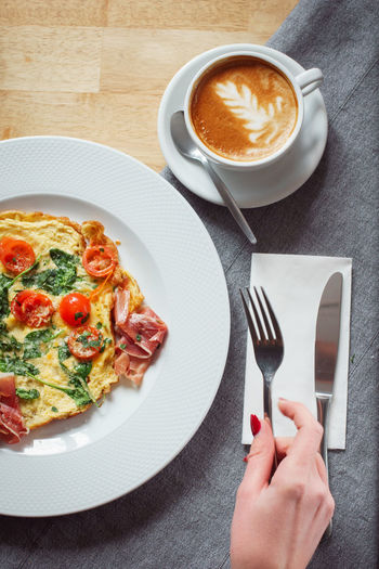 super tasty morning it was! Breakfast Coffee Cutting Eating Ham Knife Latte Morning Paella Red Wood Cloth Coffee Cup Eggs Forest Gray Hand Indoors  Latteart Plate Spinach Table Tomato Water Woman Hand
