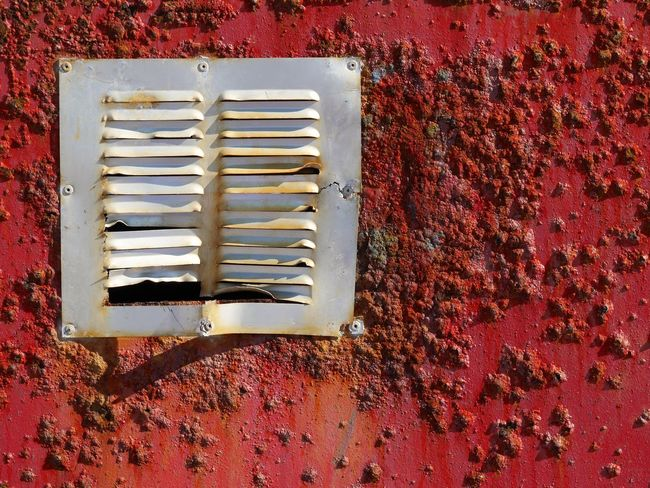 Red Rusty Pealing Paint Vent