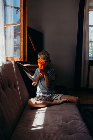 EyeEm Best Shots Games Gun Kids Natural Light Portrait The Week on EyeEm Boys Child Childhood Eye4photography  Home Interior Indoors  Leisure Activity Lifestyles Light And Shadow Window