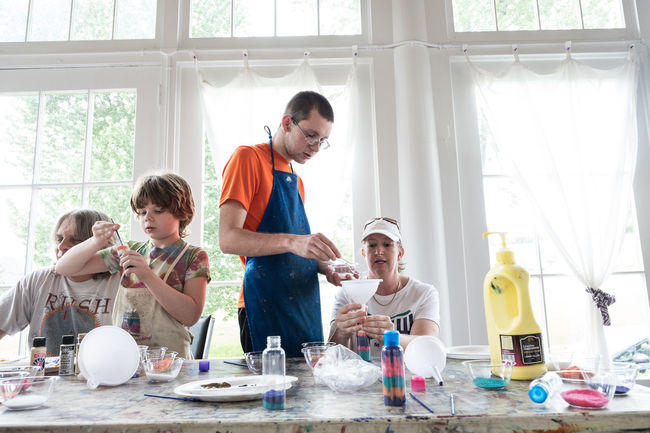 Two young special needs children enjoy an art and music therapy session in New York. Art Autism Boy Boys Care Casual Clothing Cute Day Enjoyment Fun Group Leisure Activity Lifestyles Painting Portrait Special Needs Child Therapy