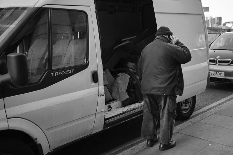 Man with van, London, UK - February 2018 Streetphotography Mode Of Transportation Land Vehicle Real People Transportation Men Motor Vehicle People City Rear View Occupation Full Length Street Car Day Standing Two People Public Transportation Working Bus Warm Clothing My Best Photo Streetwise Photography