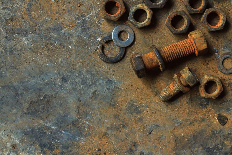 High angle view of rusty work tools on marble