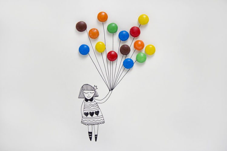 High angle view of multi colored balloons against white background