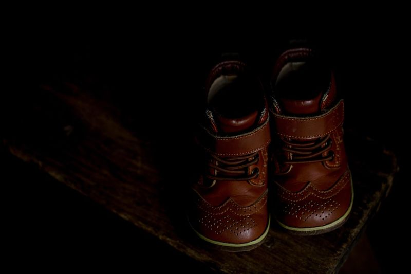 Vintage leather kids shoes Old Style Shoes Old Style Kids Shoes Brown Leather Vintage Shoes Vintage Style Vintage Studio Shot Brown Fashion No People Black Background Group Of Objects Lifestyles Personal Accessory Togetherness