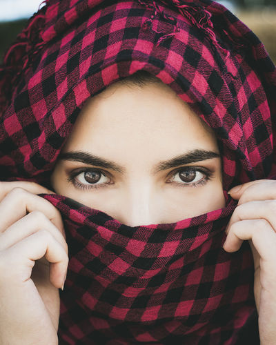 Close-up portrait of woman wearing headscarf