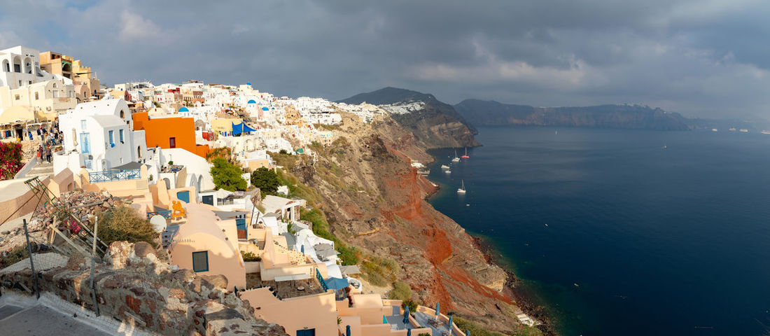 Greece Santorini Oia Thira Architecture Building Exterior Built Structure Water City Building Sea Sky Residential District Mountain Cloud - Sky Nature High Angle View Town Day Beauty In Nature No People Scenics - Nature Outdoors TOWNSCAPE