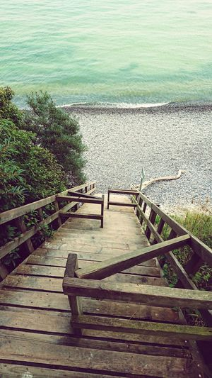 Sea Møns Klint Water Day Railing High Angle View Tranquility Outdoors Tranquil Scene Wood Paneling Nature Jetty No People Beauty In Nature The Way Forward Scenics Horizon Over Water Grass