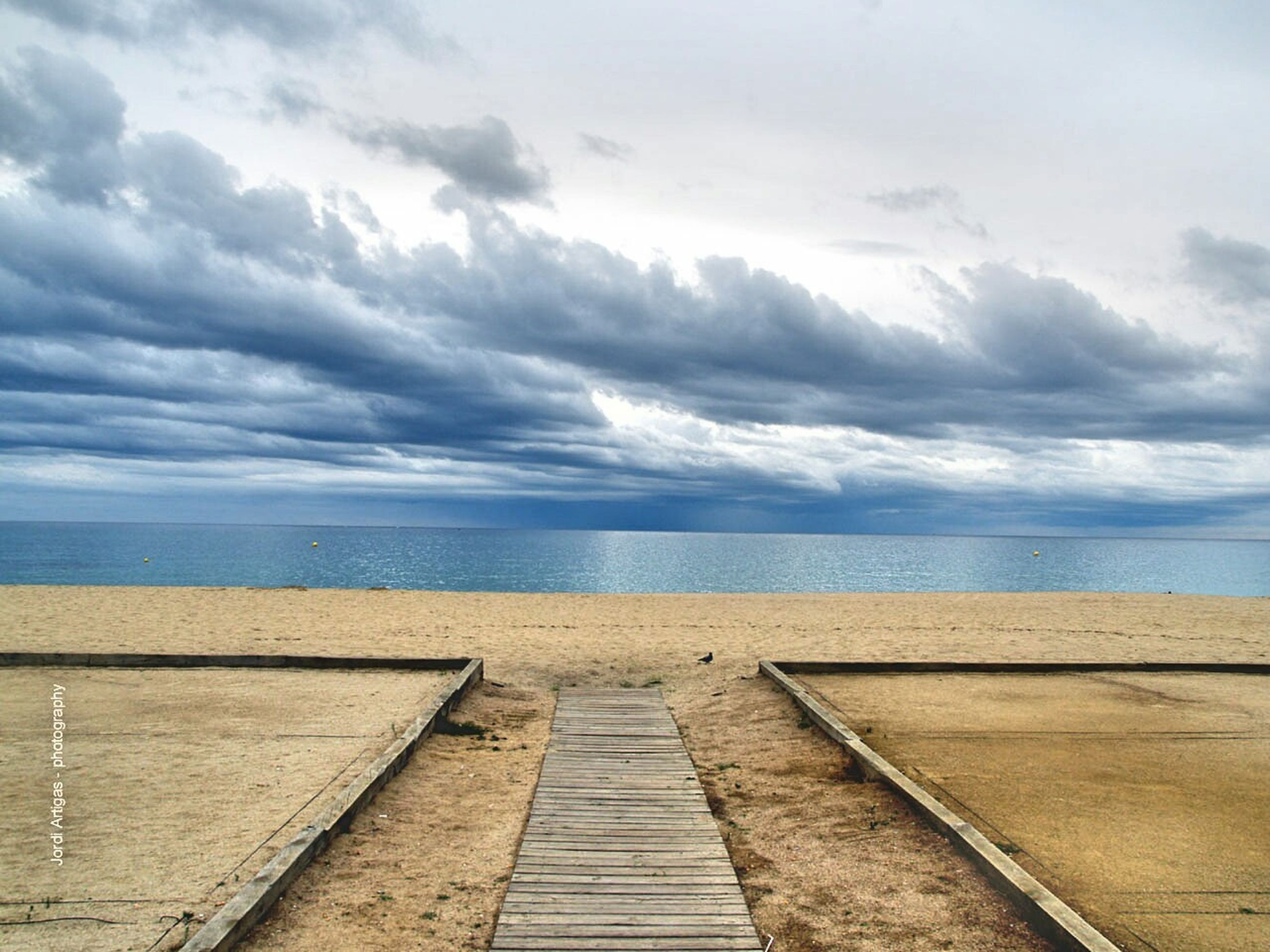 sea, beach, tranquil scene, the way forward, outdoors, horizon over water, tranquility, cloud - sky, sand, no people, water, scenics, beauty in nature, day, sky, nature, wheelchair access