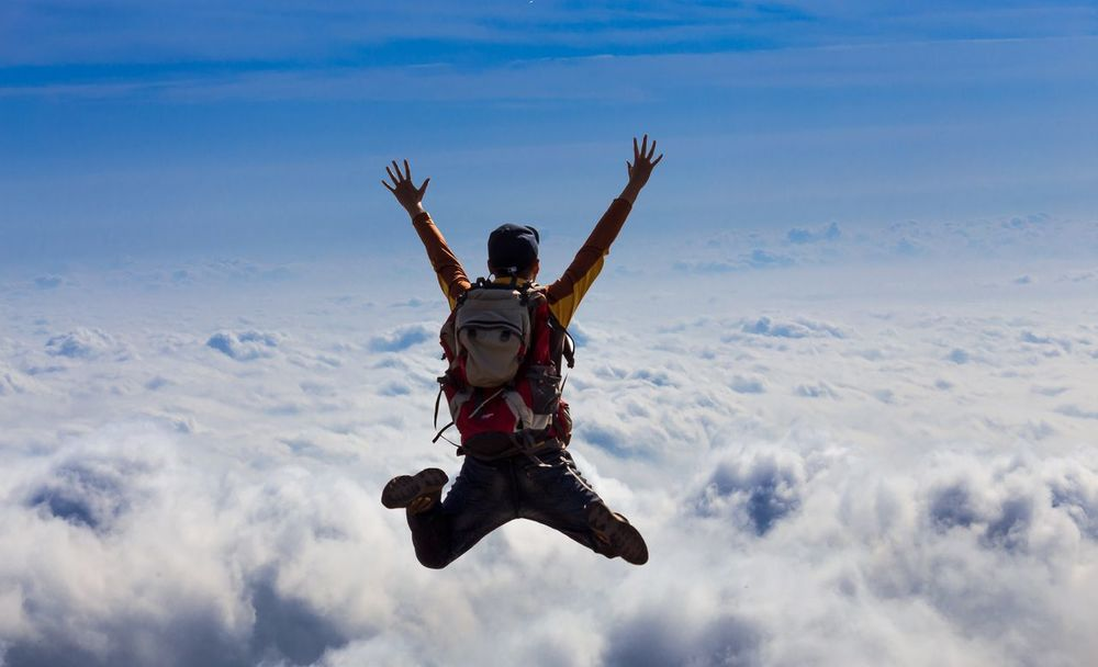 Cloud Clouds And Sky Outdoors Nature Cloud - Sky Sky One Person Motion Jumping Full Length Mid-air Exhilaration Leisure Activity Arms Raised Lifestyles Adventure Real People Freedom Fun Day Excitement Arms Outstretched Men Low Angle View