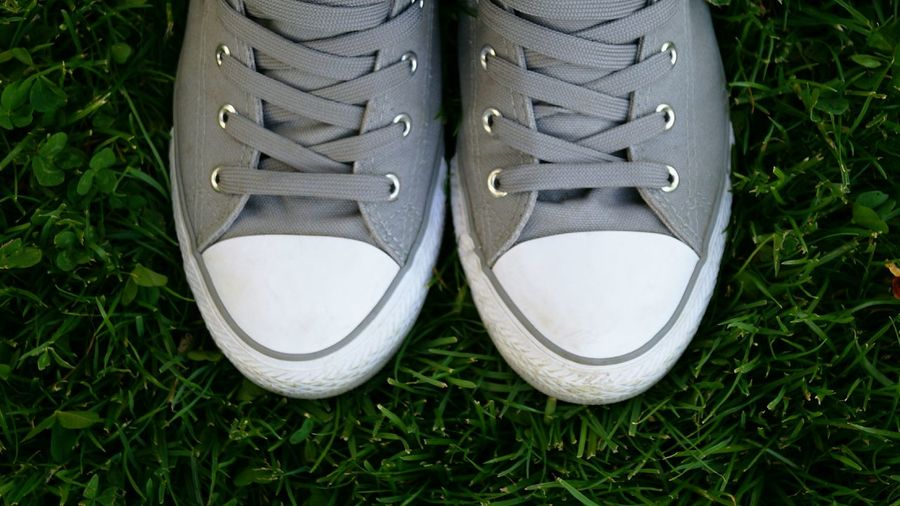 Shoe Grass Pair Pair Of Shoes High Angle View Outdoors Close-up Close Up Soccer Shoe Grey Shoes Shoes EyeEmNewHere Out Of The Box VansShoelace Low Section Sneakers Sneaker Grey