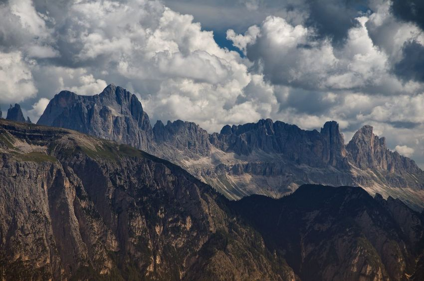 The Catinaccio or Rosengarten group, Italian Dolomites, seen from above Bolzano Italy Mountains Clouds Cloudscape Clouds And Sky Landscape Dolomites Catinaccio Rosengarten Rock Wilderness Outdoors Panorama Nature Peaks Cliff Adventure