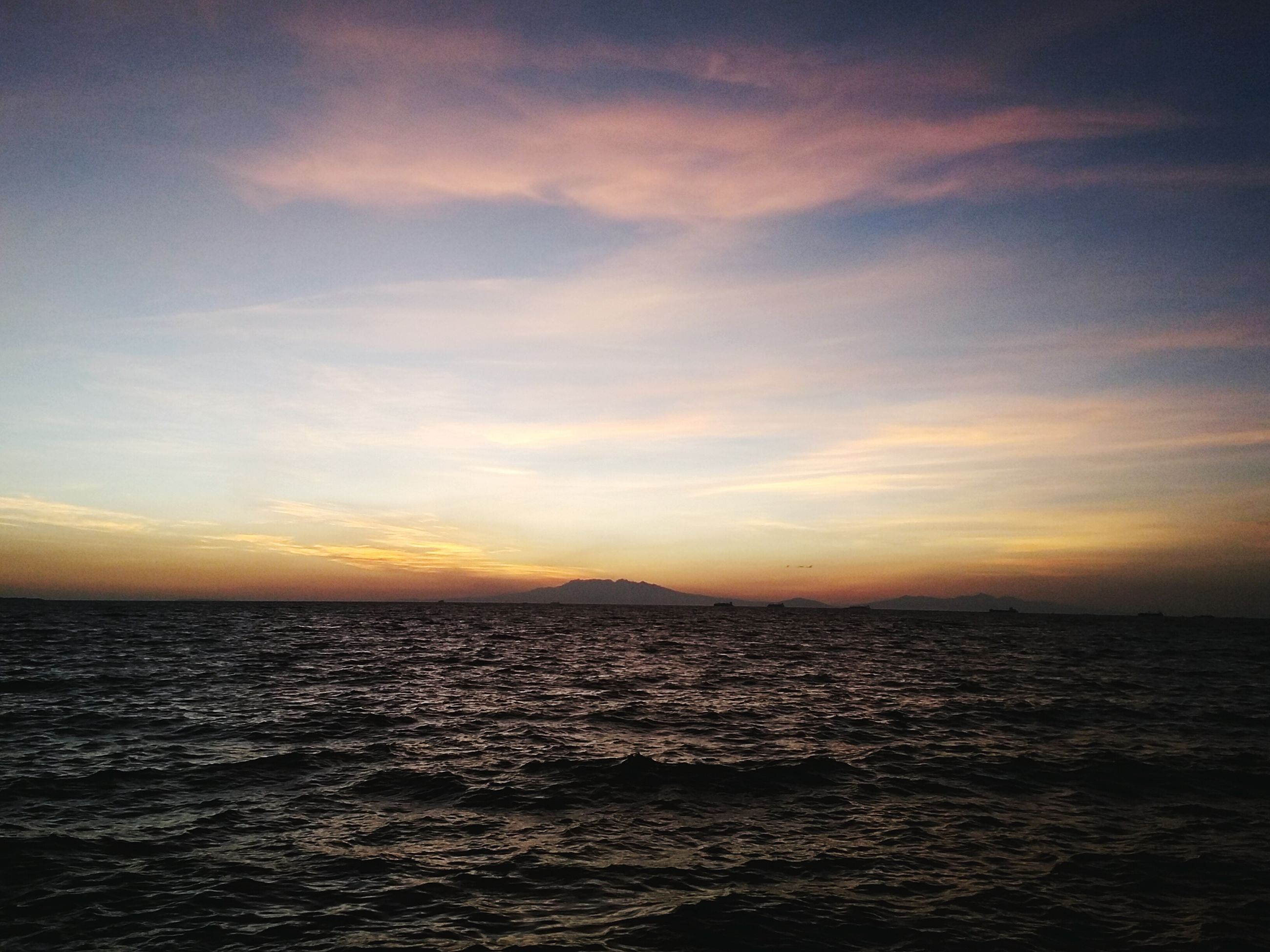 sea, water, waterfront, horizon over water, scenics, tranquil scene, sky, beauty in nature, tranquility, sunset, rippled, nature, idyllic, seascape, cloud - sky, cloud, outdoors, no people, ocean, cloudy
