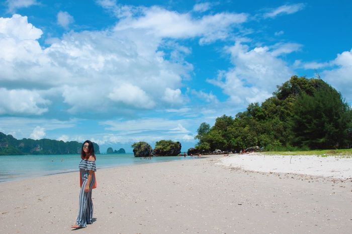 At the Sea Sky Cloud - Sky Land Beach One Person Tree Real People Women Sand Sea Rear View Lifestyles