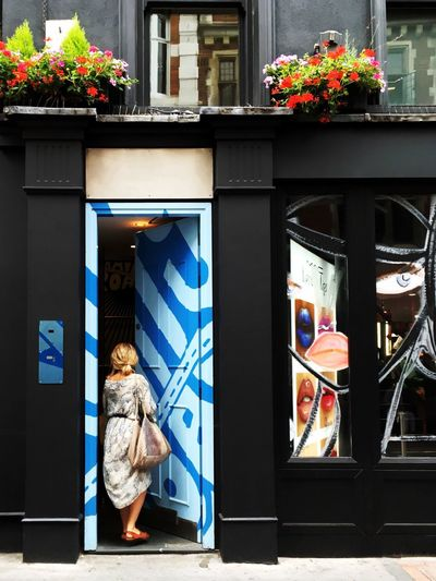 Love Yourself Postcode Postcards London Uk United Kingdom Person Woman Young Store One Person Building Exterior Day Entrance Door Entering Blonde Female Shop Shopping Window Blue Door Flowers Dress City Urban Capture The Moment Colour Your Horizn The Street Photographer - 2018 EyeEm Awards