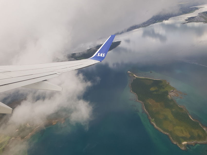 Honningsvag Northern Norway Aerial View Air Vehicle Airplane Arctic Circle Beauty In Nature Cloud - Sky Day Environment Flying Mode Of Transportation Mountain Nature No People Northcape Outdoors Plane Scenics - Nature Sea Sky Smoke - Physical Structure Transportation Travel Water