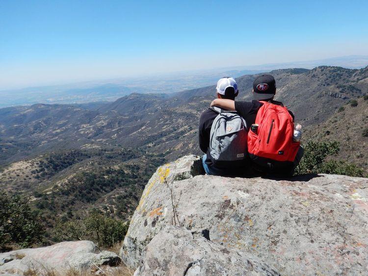 Brothers The Week on EyeEm Panoramic Hiking Highlands Family Bonding Togetherness Mountain Sitting Adventure Friendship Men Arid Landscape Mountain Range The Great Outdoors - 2018 EyeEm Awards