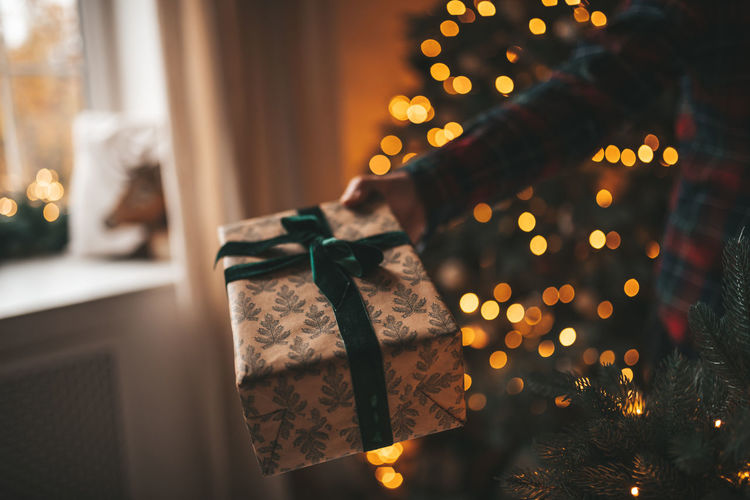 Close-up of illuminated christmas tree at home