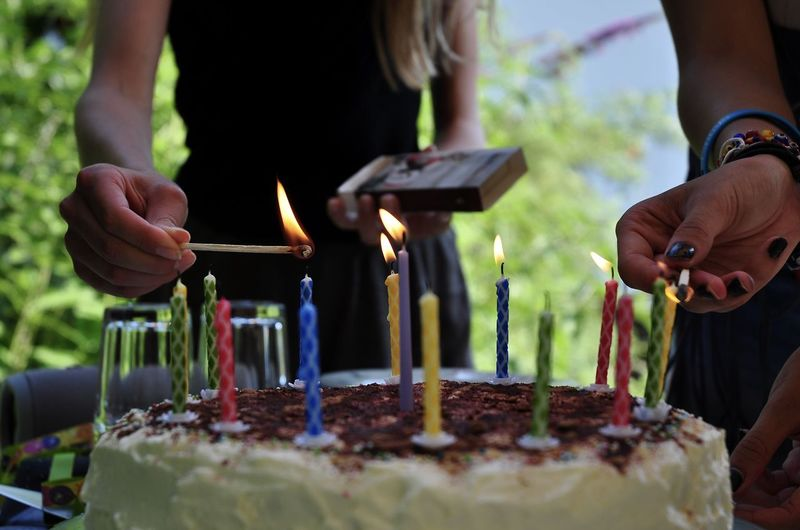 Eating Anniversary Birthday Birthday Cake Birthday Candles Black And White Burning Cake Candle Dessert Fire Food Food And Drink Freshness Hand Happy Birthday! Holding Human Hand Indulgence Lifestyles Midsection Outdoors Real People Sweet Food Temptation