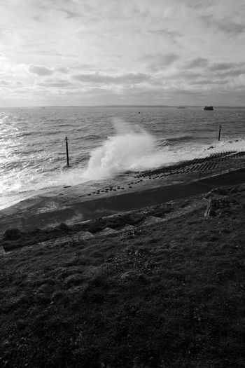 Surf In The Wind Sky Sea Water Horizon Cloud - Sky Beauty In Nature Land Beach Horizon Over Water Nature Scenics - Nature Wave Motion Outdoors Power In Nature Breaking Surf Blackandwhite Black And White