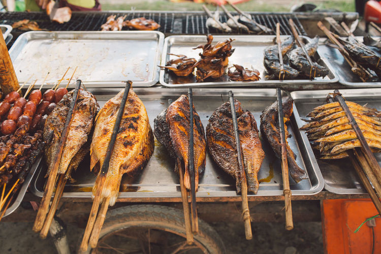 High Angle View Of Grilled Fishes For Sale At Market