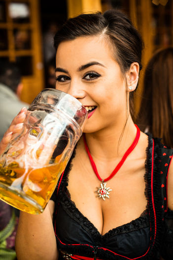 Portrait Of Woman Drinking Beer At Oktoberfest