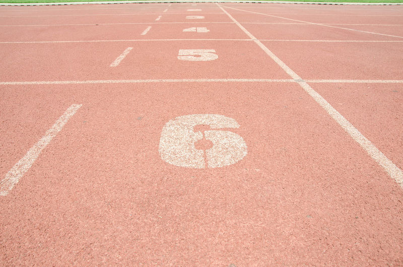 running track . Track roll in the stadium. Treadmill close up Stadium Absence Beginnings Brown Competition Competitive Sport Dividing Line In A Row No People Number Outdoors Red Running Track Sport Sports Track Track And Field Track Event