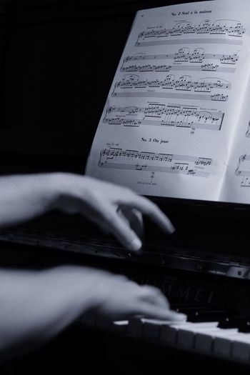 Piano Moments Human Hand Music Close-up Indoors  One Person Real People Musical Instrument Arts Culture And Entertainment Text Human Body Part Paper Black Background Day Piano Black & White Hands