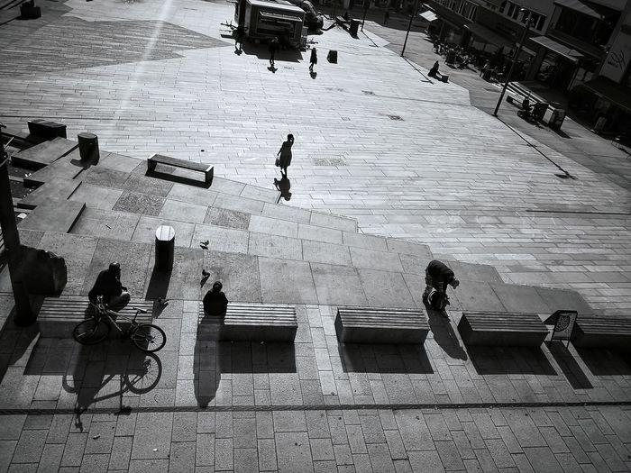 The Woman in summer dress (walking away) ❤️ Town Square Market Bright Norway Springtime Woman African Woman In Dress Shadows & Lights Sun Market Marketplace Huawei Mate 10 Pro Leica Lens Blackandwhite Full Frame Pattern Sunbeam Shining Pigeon Bird