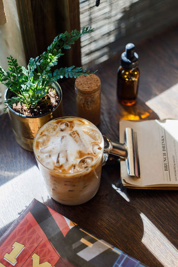 Food And Drink Table Drink Refreshment Freshness Food High Angle View Still Life No People Cup Wood - Material Coffee Indoors  Container Coffee - Drink Eating Utensil Potted Plant Close-up Mug Publication Glass Tray Temptation