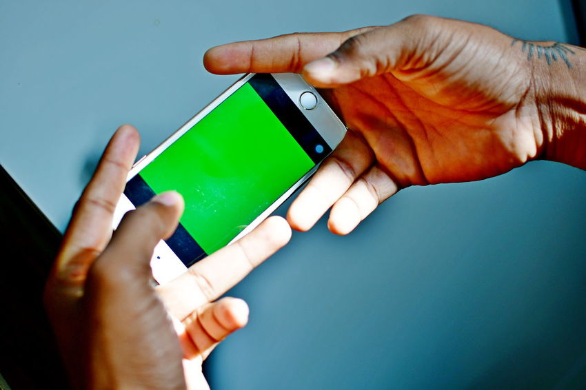 Green screen ready backdrop android phone in the hands Green Green Green!  Green Screen Backdrop Chroma Key Close-up Day Green Screen Ready Holding Human Body Part Human Hand Indoors  One Person People Real People