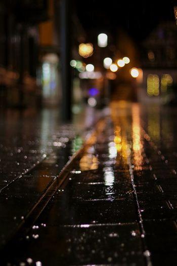 Surface level of wet street in rainy season at night