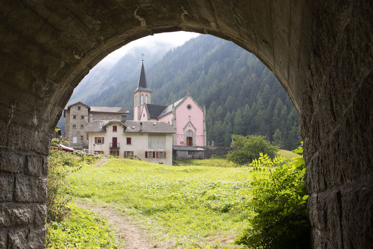 The Pink Church Trient Built Structure Architecture Building Exterior Arch Plant No People History The Past Grass Place Of Worship Outdoors Building Trient Pink Church Switzerland A New Perspective On Life
