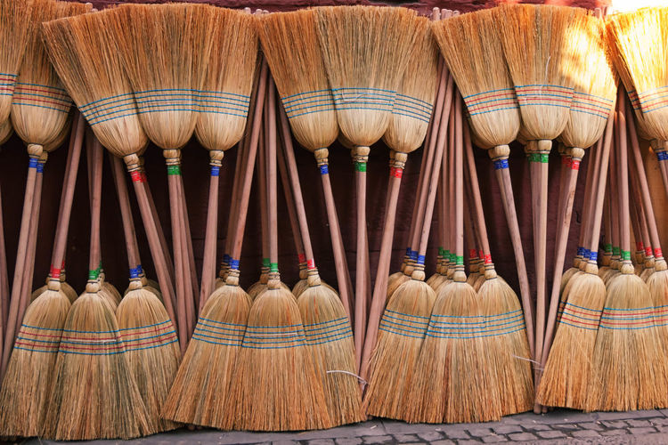 Brooms Abundance Arrangement Background, Broom, Brush, Clean, Cleaning, Domestic, Equipment, Green, Handle, Housework, Neat, New, Object, Red, Single, Tool, Vertical, White Broom Broomstick Choice Close-up Collection Day Group Of Objects In A Row Large Group Of Objects Multi Colored No People Repetition Side By Side Still Life Straw, Wooden, Stick, Handle Textile Variation