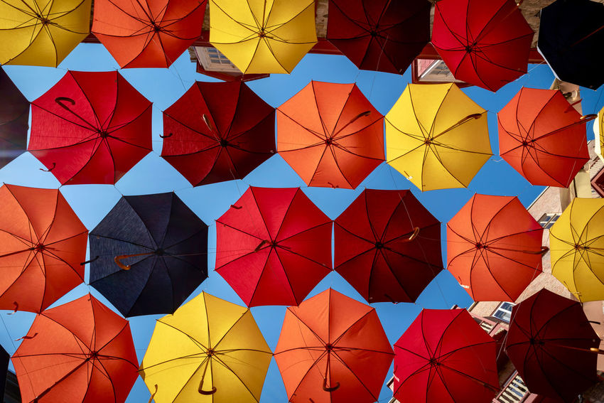 Colors Architecture Arts Culture And Entertainment Backgrounds Blue Sky Choice Colorful Creativity Day Design Full Frame Hanging Large Group Of Objects Low Angle View Multi Colored No People Outdoors Pattern Protection Shape Side By Side Umbrella Umbrellas Variation Yellow